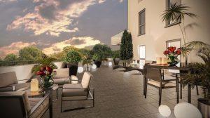 investisseur immobilier locatif-terrasse salon de jardin transat lampes allumés plantes ciel sombre