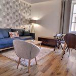 Investissement locatif meublé séjour appartement fauteuil canapé fenetre