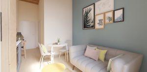 vente appartement-séjour canapé table chaises coin cuisine équipée vue sur l'entrée